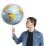 Boy turns the globe