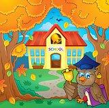 Owl teacher near school building theme 1