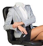 Half-turned woman body sitting in chair