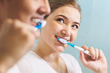 Couple Washing Teeth Man And Woman Together In Bathroom