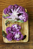 purple broccoli on a wooden table, rustic still life