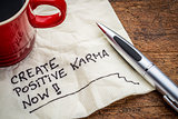 create positive karma - text on napkin