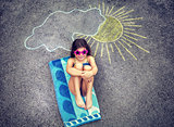 Little girl relaxing on asphalt