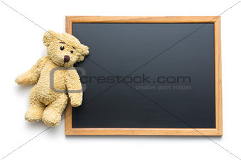 blank chalkboard and teddy bear
