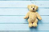 teddy bear on blue table