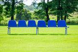 blue plastic bench on green grass