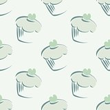 Seamless vector pattern with cupcakes on mint green background.