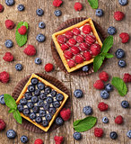 sweet cakes with fresh berries