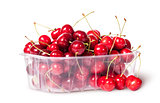 Red sweet cherries in plastic tray rotated and three near