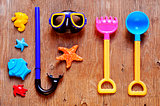 summer stuff, such as a diving or beach toys, on a rustic wooden