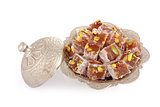 Turkish delights with pistachio nut in a metal sugar bowl isolat