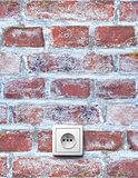 Old brick wall with socket