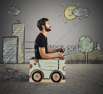 Cardboard car in drawing city