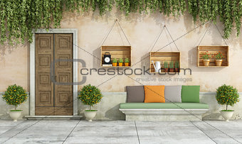 Country house with old door and stone bench