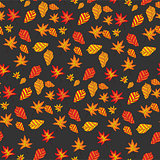 seamless pattern with autumn leaves on a dark background