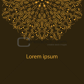 card with an ornament from autumn leaves on a dark brown background