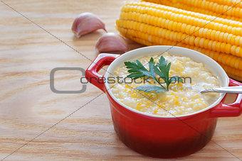 Brazilian corn soup canjiquinha in red bowl