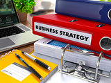 Red Ring Binder with Inscription Business Strategy.