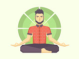 Man meditates in the Lotus position.