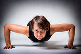 Middle aged woman doing push-ups
