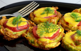 appetizer of  zucchini tomato and cheese