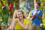 Grinning Woman Listening to Musician