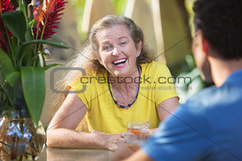 Adult Female Laughing with Friend