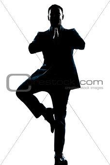 business man yoga tree pose  silhouette