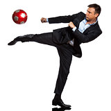 one business man playing kicking soccer ball