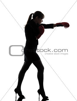 business woman punching boxing gloves silhouette