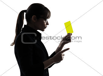 business woman showing yellow card silhouette