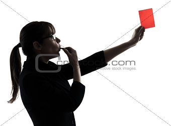 business woman whistling showing red card silhouette