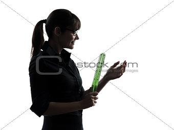 business woman teacher holding   ruler silhouette