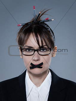 business woman with tape on lips