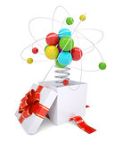 Gift box with red band and colorful atom structure