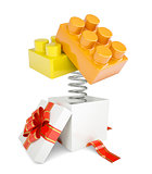 Gift box with red band and toy bricks