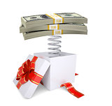 Gift box with red band and dollar packs on spring