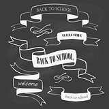 Set of back to school badges and ribbons on chalkboard