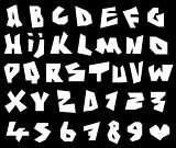 paper cut font and number alphabet in white over black