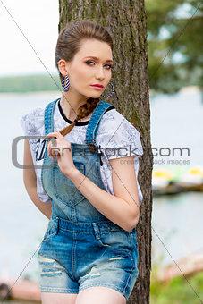 casual woman near lake
