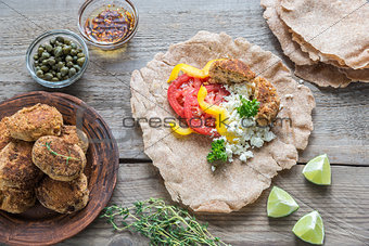 Appetizer with falafel, cottage cheese and vegetables