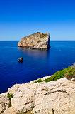 Peaceful landscape view of ocean coast and rocky island, Sardinia