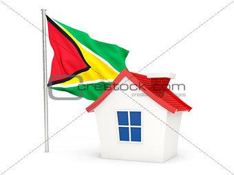 House with flag of guyana