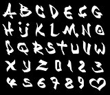 graffiti marker font and number alphabet over black