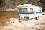 Classic Old Camper Trailer Near A River