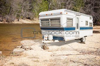 Classic Old Camper Trailer Near A River