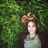 Beautiful young meditative woman in the grass. Instagram retro e