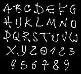 white liquid font and number alphabet over black