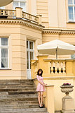 vintage palace , with pink woman on stairs