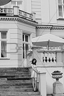 BW image vintage palace , with pink woman on stairs
